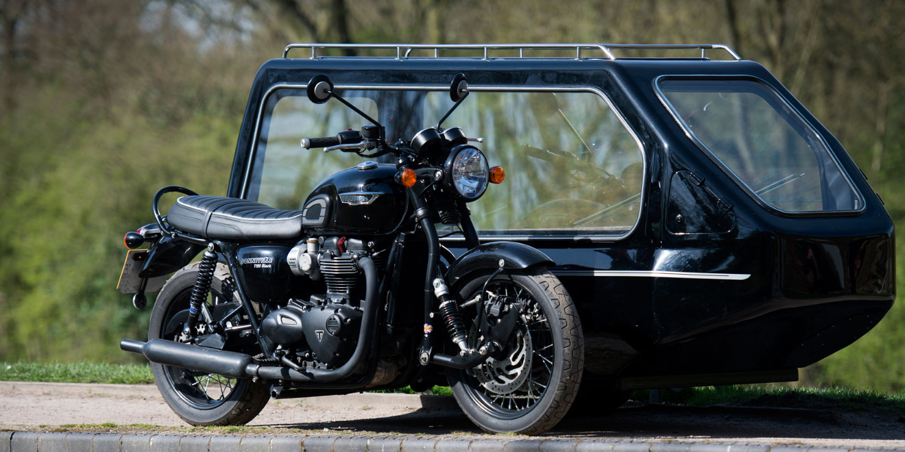 A motorcycle sidecar hearse transportation for a funeral